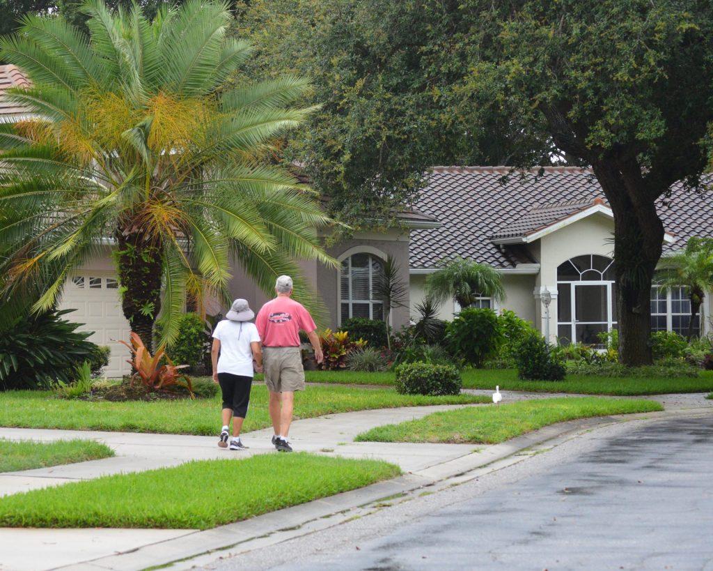 people walking on the sidewalk in Park Estates