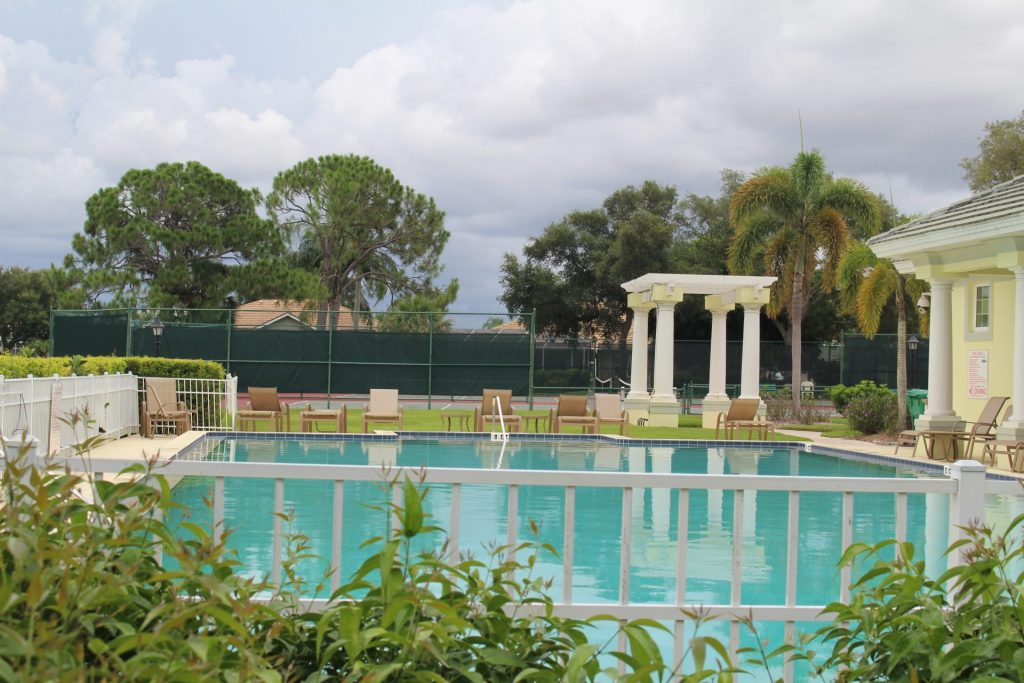 pool at the LOJ clubhouse with tennis courts in the background