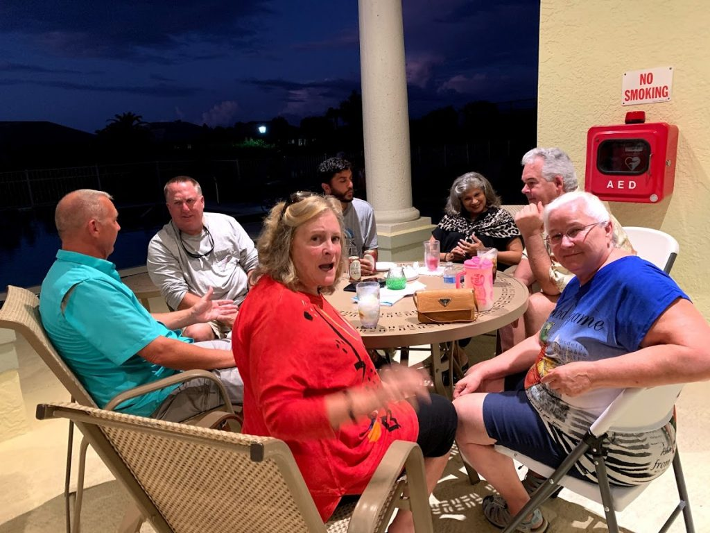 group of people on the patio at the clubhouse