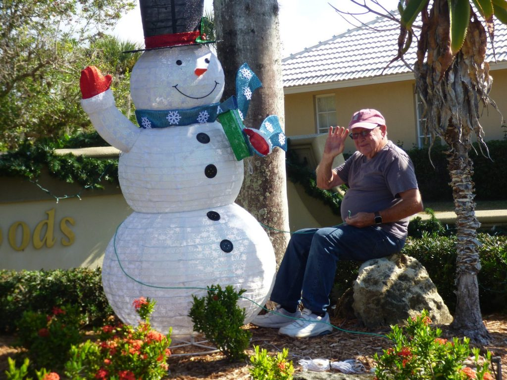 man with an inflatable snowman
